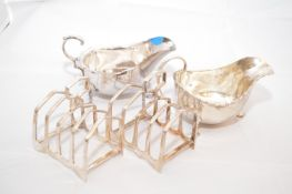 Two silver sauce boats; and two plated toast racks