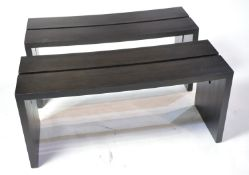 A pair of designer ebonised benches.