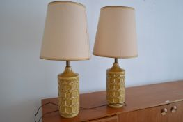 A pair of mid Century pottery geometric pattern table lamps.