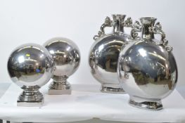 Pair of silvered vases; and a pair of silvered ball ornaments.