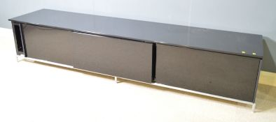 A piano black low side unit, possibly by Minotti.