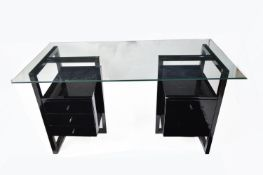 A modern black lacquered and glass desk.