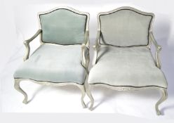 A pair of designer French style armchairs.