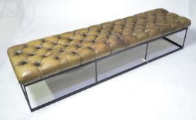A faux leather button upholstered bench.