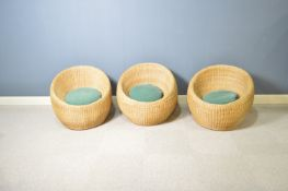 Attributed to Isamu Kenmochi for Yamakawa Rattan: three rattan lounge chairs.