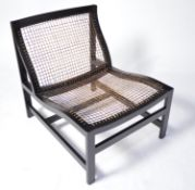 Modern canework and ebonised easy chair.