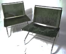 A pair of designer low slung chairs.