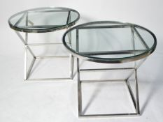 Manner of Eichholtz: a pair of chromed metal occasional tables.