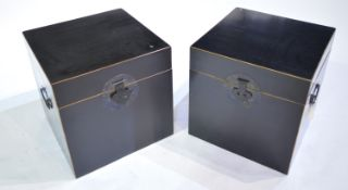 Pair of modern Chinese ebonised two-handled boxes.