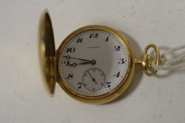 An 18ct. yellow gold Longines Hunter pocket watch.