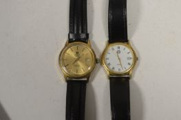 A Tissot wristwatch and another.
