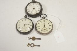 Three silver-cased pocket watches.