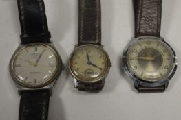 Three steel-cased wristwatches.