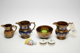 Three copper lustre jugs, the pair with blue band decoration, and another, a sugar bowl; a pair of