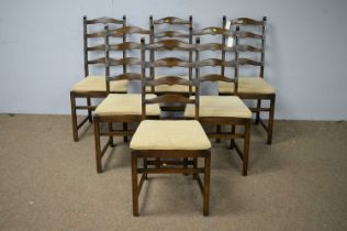 Set of six Ercol ladder back dining chairs.