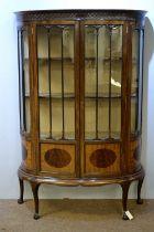 20th Century mahogany bowfront display cabinet.