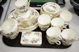 Wedgwood bone china part tea services; and a box and cover.