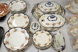 A Ridgway's Dinam pattern earthenware dinner service