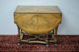 An early 20th Century Queen Anne style walnut drop leaf dining table