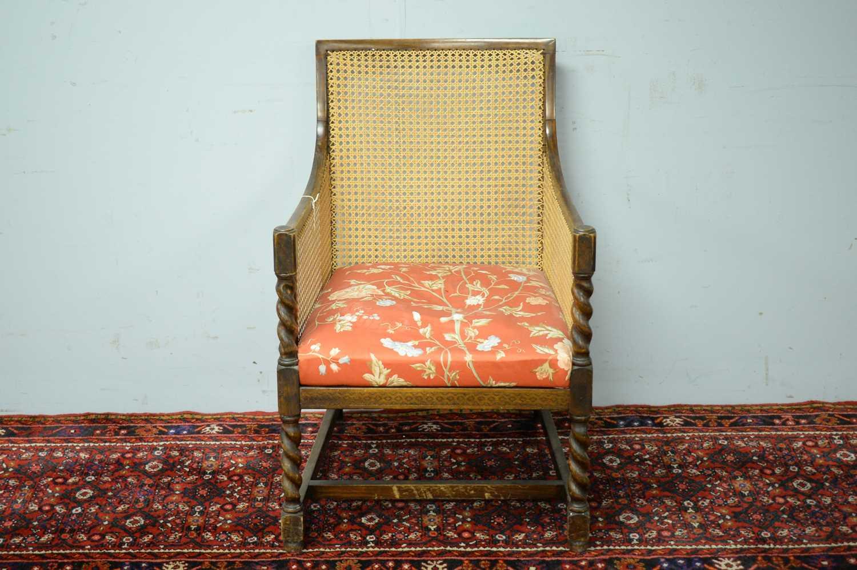 A late 19th Century oak bergere chair