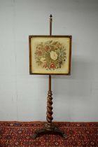Victorian mahogany pole screen.