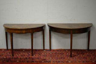 Two 19th C mahogany demi lune side tables.