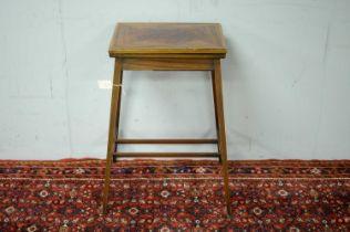 An Edwardian mahogany card table
