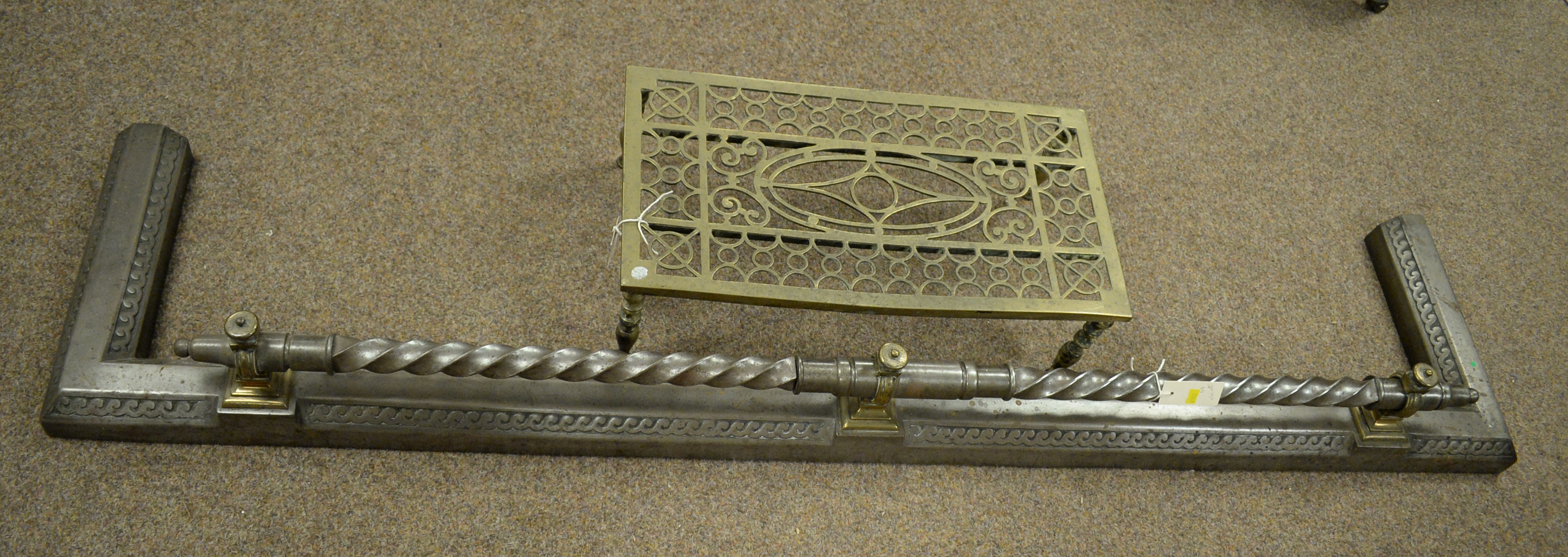 19th C brass trivet and fire curb