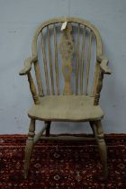 A late 19th Century ash and elm Windsor chair, hoop top rail with pierced and spindle back above