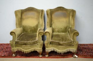 Pair of early 20th C wing back armchairs.