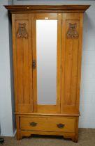 Art Nouveau style walnut wardrobe.