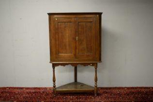 19th Century oak corner cabinet.