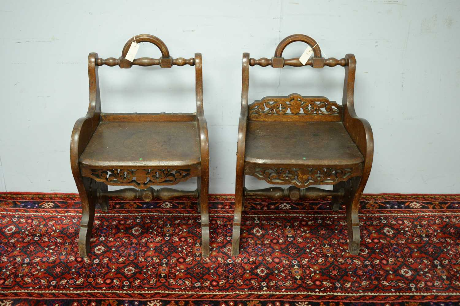 A pair of 19th Century oak hall chairs
