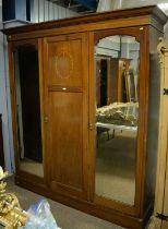 Early 20th Century mahogany three-door wardrobe.