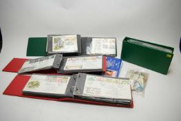 Collection of first day covers, other stamps, and tea cards.