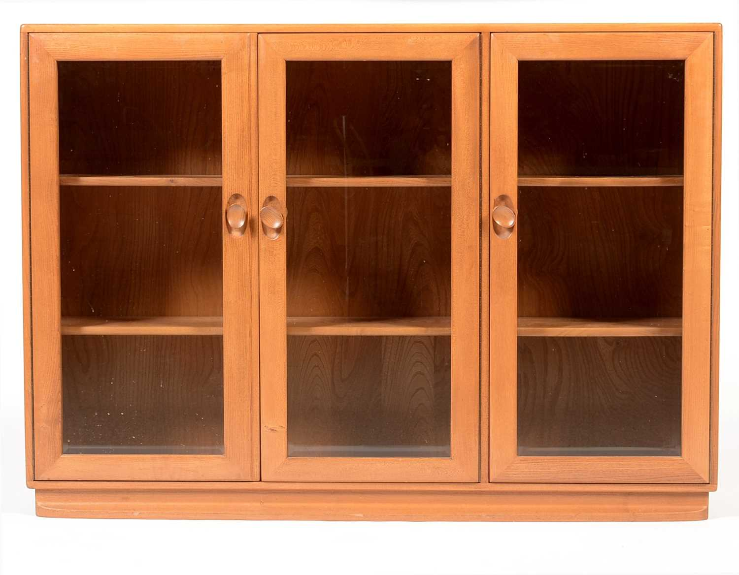 Ercol: an elm Windsor bookcase/display cabinet.
