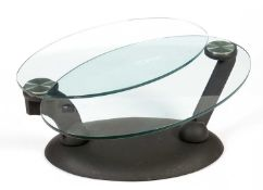 Naos, Made in Italy: a plate-glass and black painted metal adjustable coffee table.