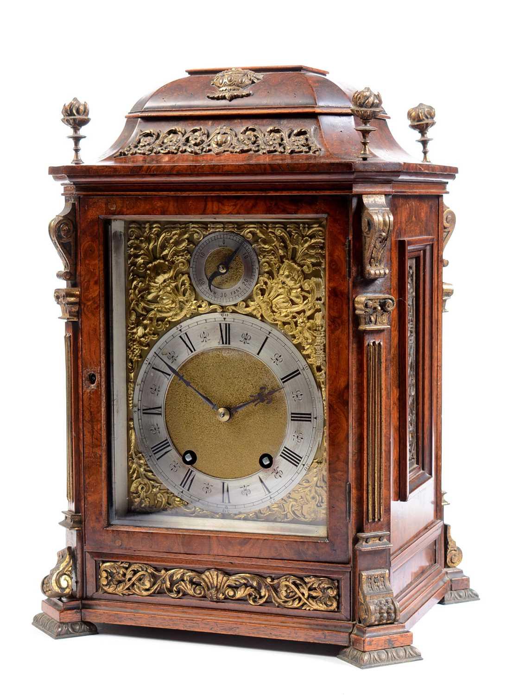 A 19th Century burr rosewood bracket clock.