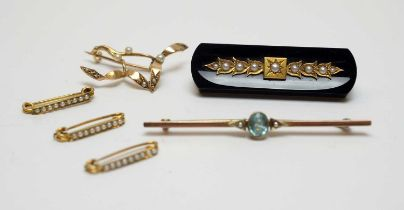 Six Victorian and Edwardian yellow-metal and seed pearl brooches.