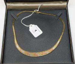 A 9ct gold tri-coloured collar necklace.