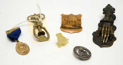 Objects of Vertu including a Mauchline Ware badge and miniature carved agate dog.