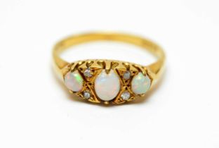 An 18ct gold, diamond and opal dress ring.