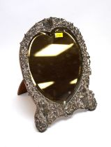 A Victorian silver framed dressing table mirror.