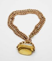An antique 9ct gold watch chain bracelet with citrine fob seal charm.