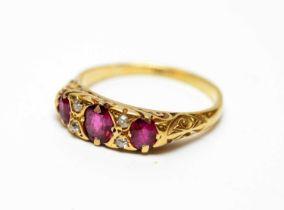 A three-stone ruby and diamond dress ring.