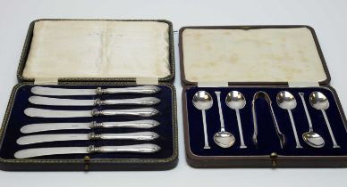 A cased set of six George V silver teaspoons and sugar tongs, and a cased set of butter knives.