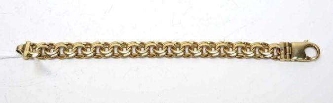 A 9ct gold double curb-link bracelet.
