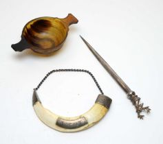 Antique horn quaich, letter opener, and whiskey decanter label.