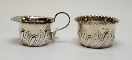 A Victorian silver milk jug and sugar bowl.