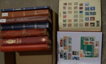 Stamps in stock books,